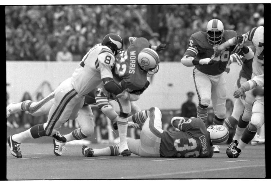 Vikings defensive end Carl Eller tackles Dolphins running back Mercury Morris.