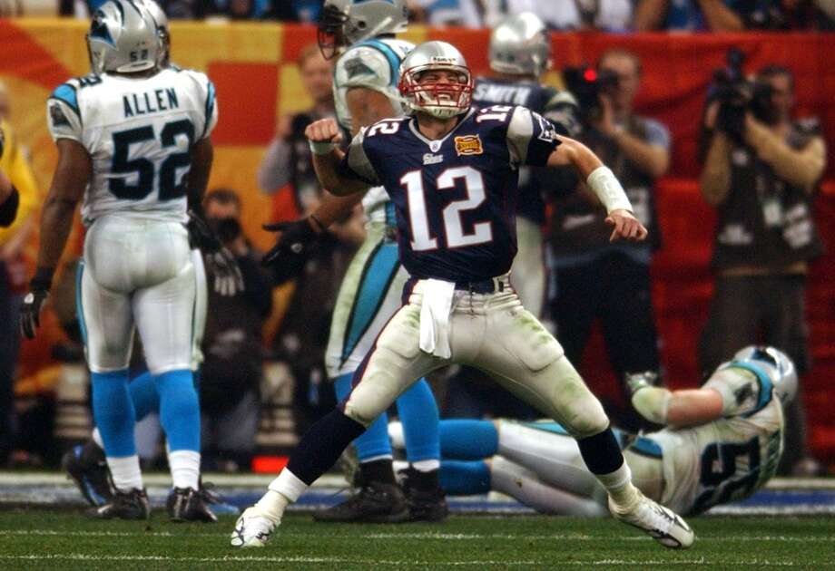 Super Bowl XXXVIIIPatriots 32, Panthers 29Patriots QB Tom Brady (12) celebrates a TD that put the Patriots ahead 21-10 in the fourth quarter.