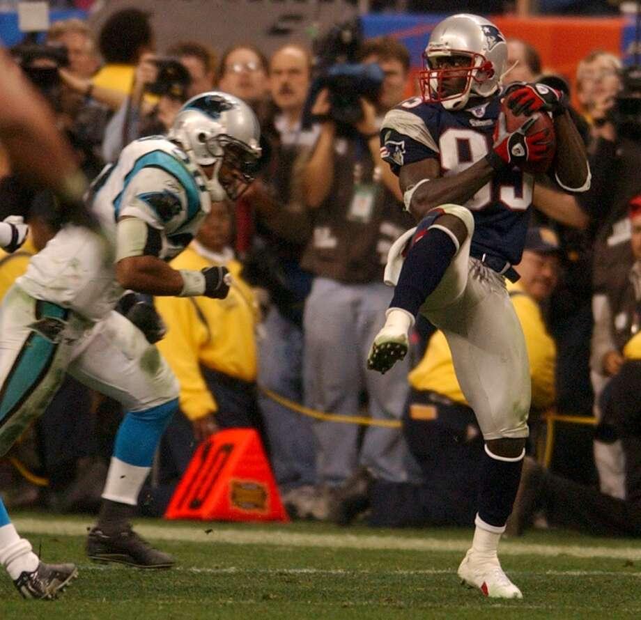 Patriots receiver Deion Branch (83) catches a 17-yard pass to set up Adam Vinatieri's game-winning 41-yard field goal.