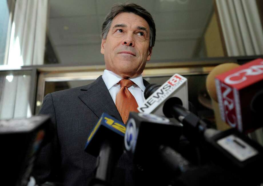 Texas Gov. Rick Perry speaks to the media before hosting a lunch appointment with Connecticut gun makers in Hartford, Conn., Monday, June 17, 2013.  The governors of Texas and South Dakota are visiting Connecticut to court local gun makers, many of which have threatened to leave since the state passed tough new gun-control laws in response to the massacre at Sandy Hook Elementary School. Photo: Jessica Hill, AP Photo/Jessica Hill / Associated Press