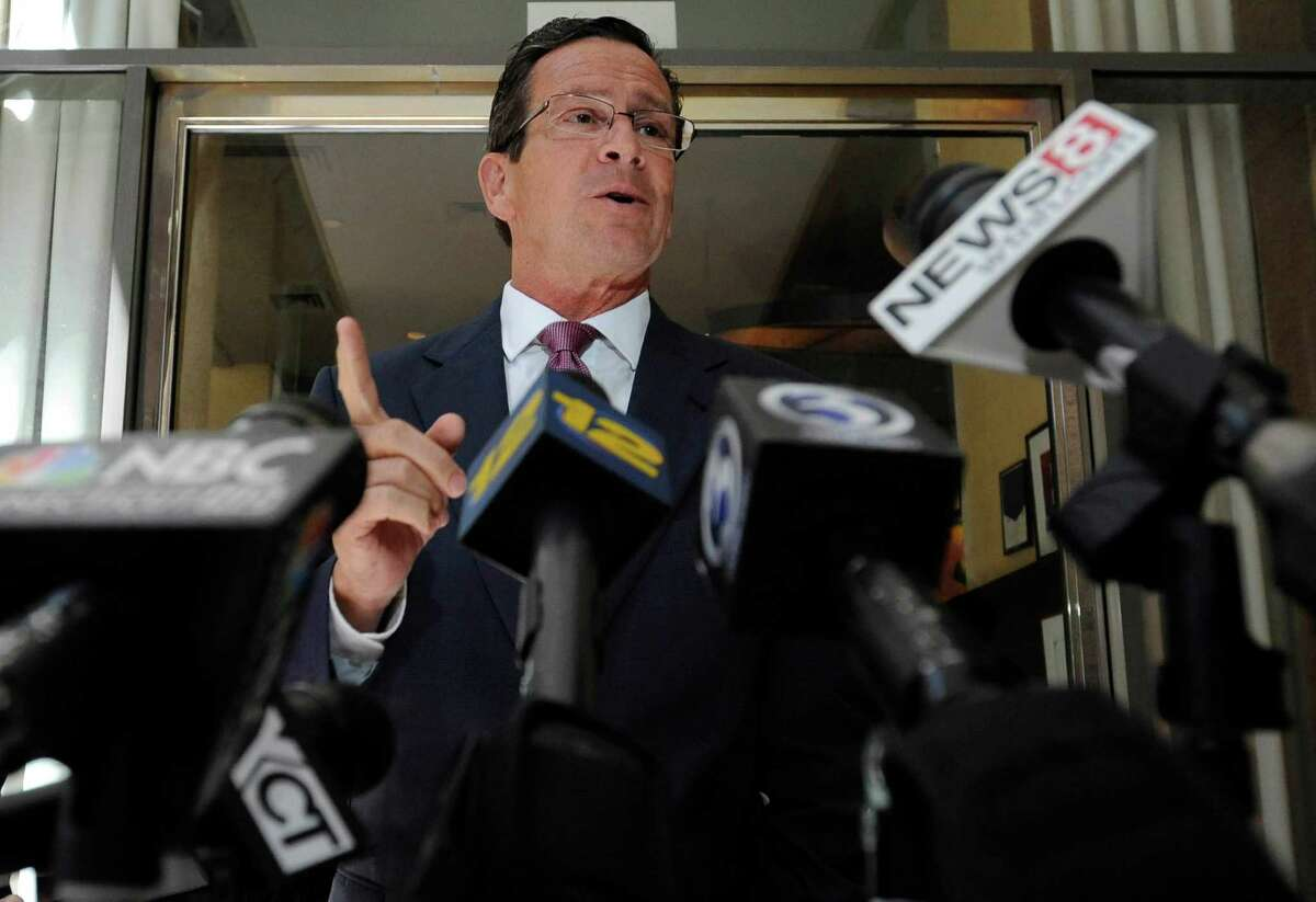 Connecticut Gov. Dannel P. Malloy briefly speaks to the media after stopping by a restaurant to welcomeTexas Gov. Rick Perry in Hartford, Conn., Monday, June 17, 2013. Perry was at the restaurant hosting a lunch appointment with Connecticut gun makers. The governors of Texas and South Dakota are visiting Connecticut to court local gun makers, many of which have threatened to leave since the state passed tough new gun-control laws in response to the massacre at Sandy Hook Elementary School.