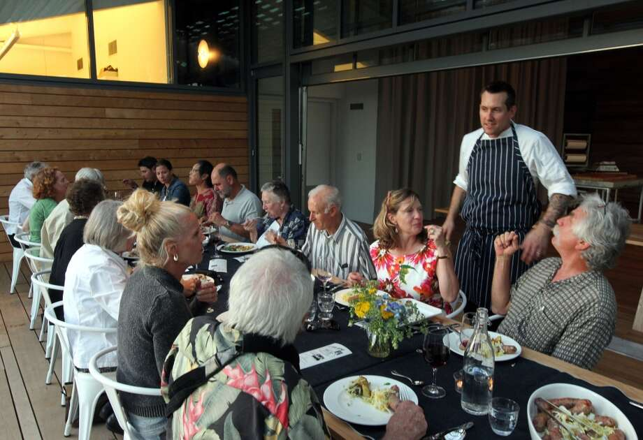 Jason Smith from Mullen and Smith pop up dinners chats with his guest prior to their pork dinner.