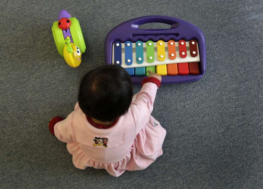 Annie Chung plays with musical toys at Chinatown's Little Sprouts Child Development Center in San Francisco, Calif. on Wednesday, June 12, 2013.
