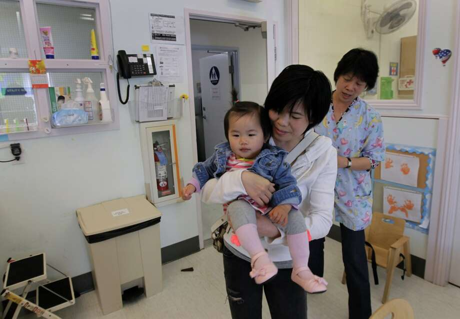 Genling Zhang and her young daughter Kirali arrives at Chinatown's Little Sprouts Child Development Center in San Francisco, Calif. on Wednesday, June 12, 2013.