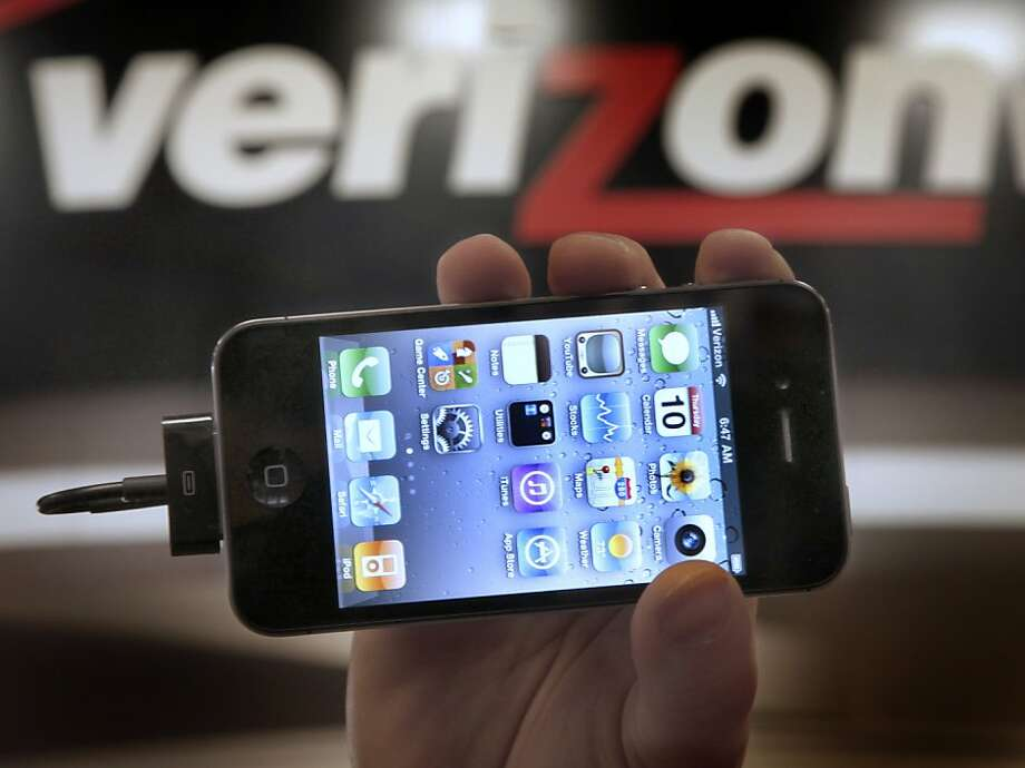 Verizon staffer with an Apple iPhone 4G, two firms the U.S. asked for data. Photo: Amy Sancetta, Associated Press
