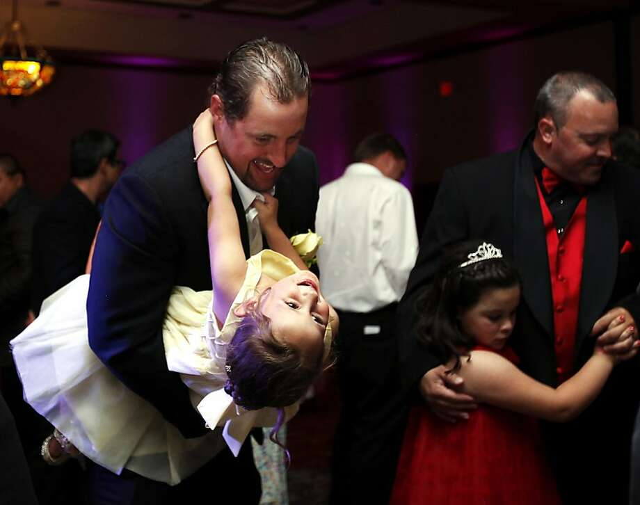 Dancing with Dad: T.J. Sparks dips daughter DeLanie during the Daddy Daughter Dance at the MCM Elegante   Hotel Ballroom in Odessa, Texas. Photo: Edyta Blaszczyk, Associated Press