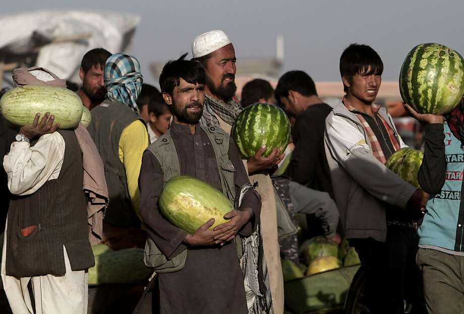 So, does anyone have any watermelon for sale?There appears to be more supply than demand at a market in Kabul. Photo: Rahmat Gul, Associated Press