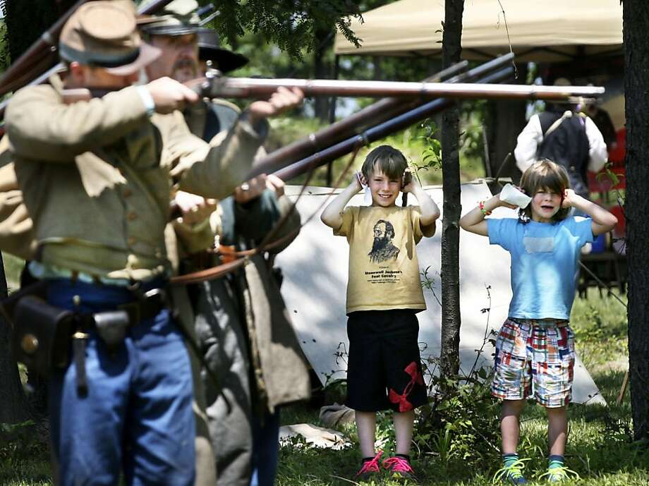 War is loud: William and Andrew Carroll, 6, cover their ears as the 10th Virginia 