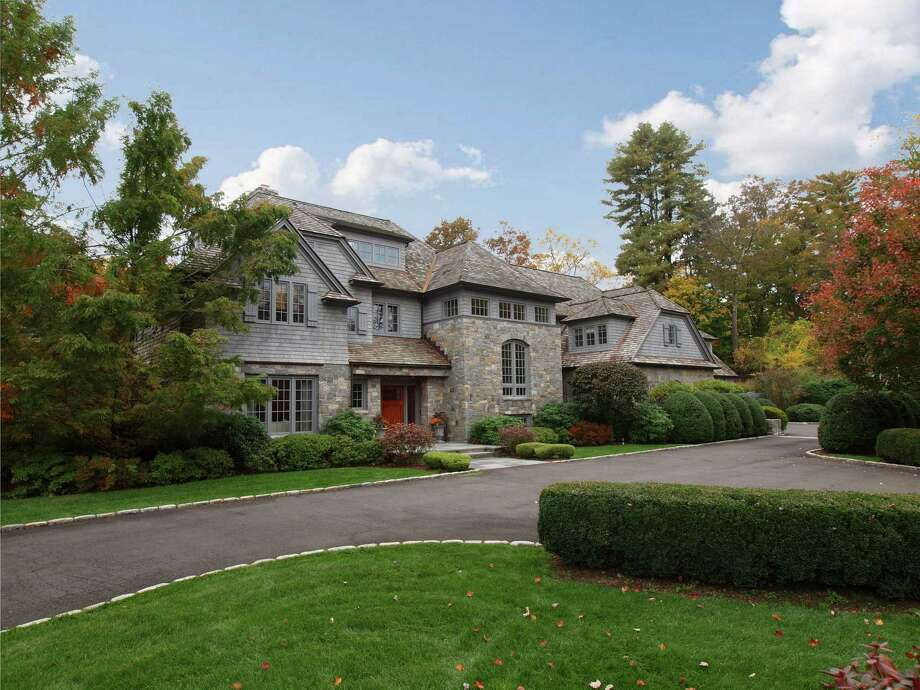 The grand colonial at 98 Lambert Road in New Canaan, on the market for $5,649,500, features 16 rooms as well as heated pool, hot tub, pool spa, wine cellar and an exercise room with mirrors.. Photo: Contributed