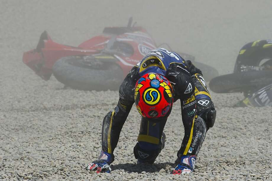 More agony of defeat: Luis Rossi of France picks himself after wiping out during the Moto2 race during the MotoGp Of Catalunya in Montmelo, Spain. Photo: Mirco Lazzari Gp, Getty Images