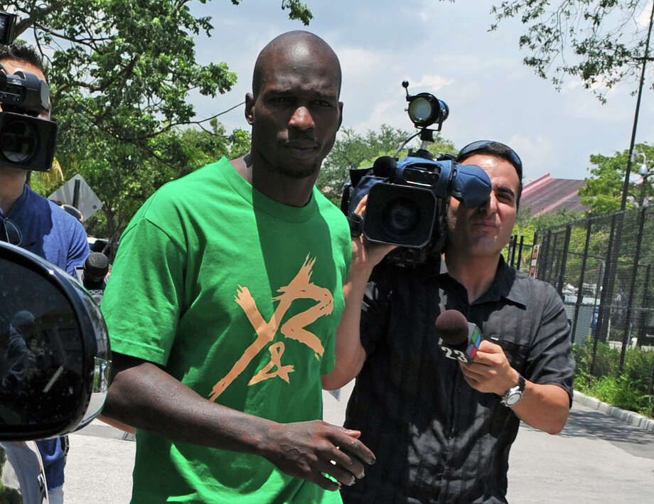 FILE - In this Aug. 12, 2012 file photo, Chad Johnson, center, leaves Broward County Jail in Fort Lauderdale, Fla. A contrite Johnson apologized Monday, June 17, 2013, for disrespecting a judge when the former NFL star slapped his attorney on the backside in court a week earlier, and his immediate release from jail was ordered. (Photo by Jeff Daly/Invision/AP, File) Photo: Jeff Daly/Invision/AP