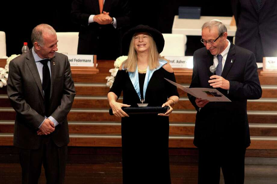 Entertainment star Barbra Streisand recives an honorary doctorate during a ceremony at the Hebrew University in Jerusalem, Monday, June 17, 2013. Streisand waded into one of Israel's touchiest issues Monday on the first major stop of her tour of the country Jewish religious practices that separate men and women. (AP Photo/Dan Balilty) Photo: Dan Balilty