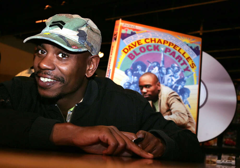 "FILE - In this June 13, 2006 file photo, comedian Dave Chappelle promotes the release of his new DVD ""Dave Chappelle's Block Party,"" at the Virgin Megastore in Los Angeles. Chappelle will make his most substantial return to stand-up comedy in a month-long tour for Funny Or Die. The reclusive comedian will headline the Oddball Comedy and Curiosity Festival, which kicks off Aug. 23, 2013, in Austin, Texas. The 13-date, two-stage tour concludes Sept. 22 in Phoenix. (AP Photo/Stefano Paltera, File) Photo: Stefano Paltera"