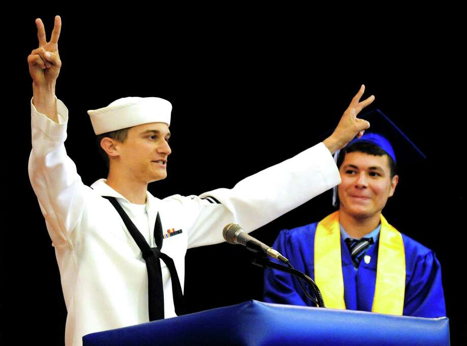 Dustin Hanson surprises his brother, Dylan, by arriving from San Diego where he serves with the U.S. Navy, as Henry Abbott Technical School holds graduation exercises in the Danbury, Conn, high school Monday, June 17, 2013. Photo: Michael Duffy / The News-Times