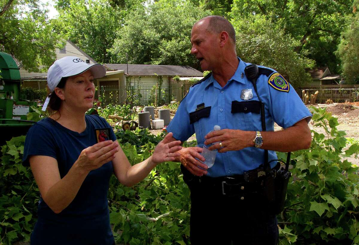 Jessica Wilt, left, argues with a police officer as a crew cuts down a historic, century-old Sycamore tree at the corner of Oxford Street and 23rd St., Monday, June 17, 2013, in Houston. Locals showed their support in keeping the tree as they stood in protest. The tree is 106-feet tall, according to the 2011 Harris County Tree Registry.