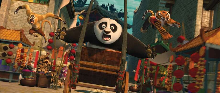 Po (Jack Black, center), Tigress (Angelina Jolie, right) and Monkey (Jackie Chan, left) are back in action chasing a runaway rickshaw in DreamWorks Animation's KUNG FU PANDA 2 to be released by Paramount on Thursday, May 26, 2011.