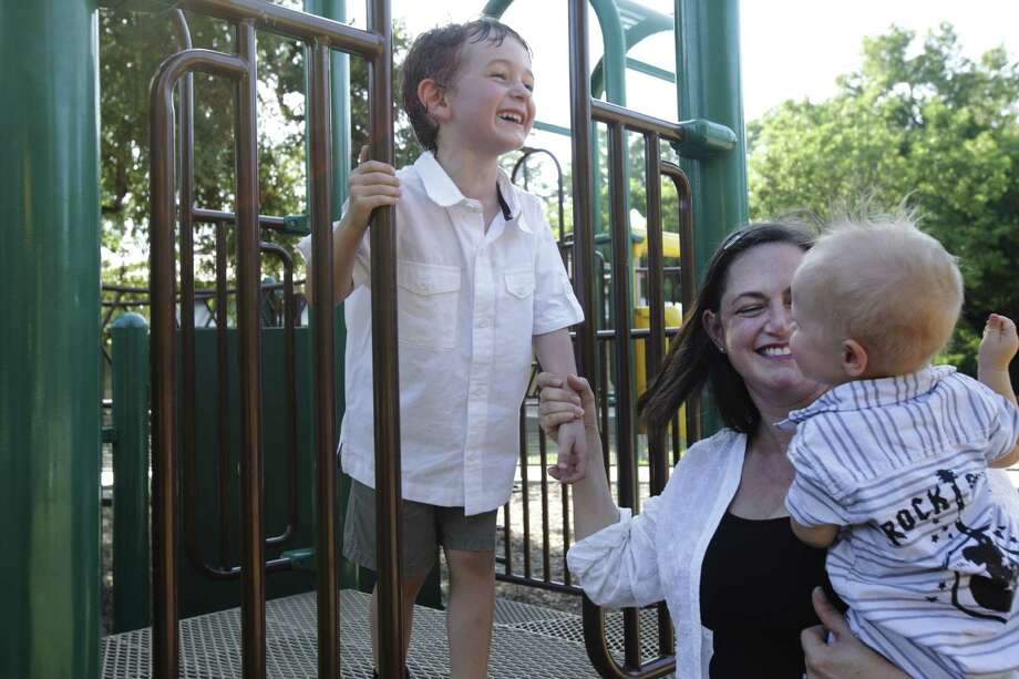 Alison Beshur plays with her sons, Frank E. Lucci, 5, and Willie Lucci, 1, at Brackenridge Park. Photo: Abbey Oldham / San Antonio Express-News