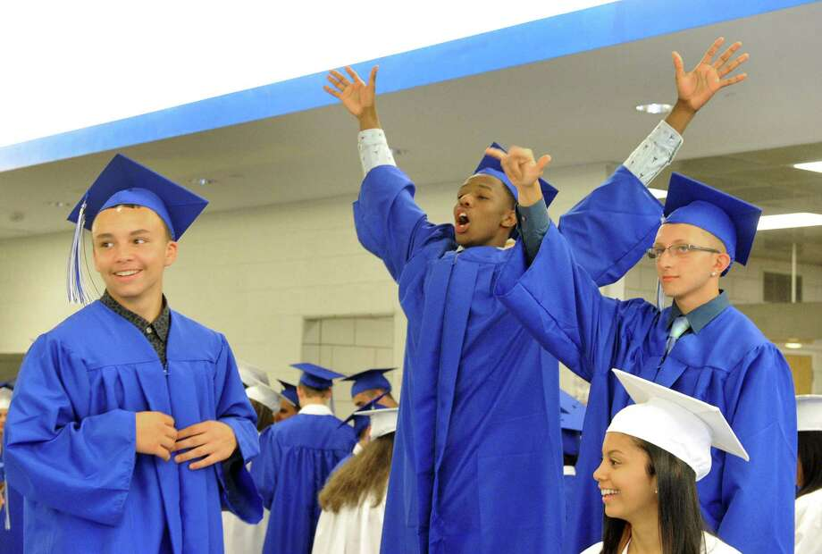 Henry Abbott Technical School holds graduation exercises in the Danbury, Conn, high school Monday, June 17, 2013. Photo: Michael Duffy / The News-Times