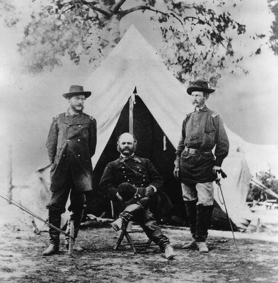 Maj. Gen. A.E. Burnside sits between two staff members near Richmond, Va., in this Civil War photo by Alexander Gardner. Photo: Encyclopaedia Britannica, Universal Images Group / Getty Images