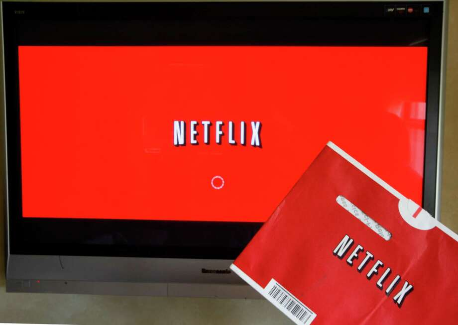 FILE - In this Oct. 1, 2011 file photo, a Netflix DVD envelope and Netflix on-screen television menu are shown in Surfside, Fla. Netflix is going to start running original television series from Dreamworks Animation, the company announced Monday, June 17, 2013. Financial terms were not disclosed. Netflix Inc. says the multi-year agreement is its biggest deal ever for original first-run content and includes more than 300 hours of new programming. It expands on an existing relationship between the companies. (AP Photo/Wilfredo Lee, File) Photo: Wilfredo Lee