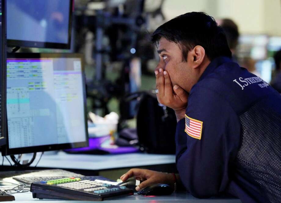 Specialist Niral Doshi works at his post on the floor of the New York Stock Exchange Monday, June 17, 2013. Stocks were up Monday because investors think Fed leaders will determine that the economy isn't recovering fast enough. (AP Photo/Richard Drew) Photo: Richard Drew