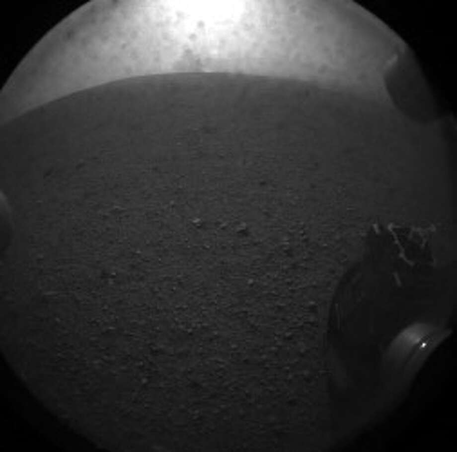 IN SPACE - AUGUST 5: In this handout image provided by NASA/JPL-Caltech, one of the first images taken by NASA's Curiosity rover, which landed on Mars on the evening of August 5, 2012 PDT and transmitted to Spaceflight Operations Facility for NASA's Mars Science Laboratory Curiosity rover at Jet Propulsion Laboratory (JPL) in Pasadena, California. The MSL Rover named Curiosity is equipped with a nuclear-powered lab capable of vaporizing rocks and ingesting soil, measuring habitability, and whether Mars ever had an environment able to support small life forms called microbe. Photo: NASA, Getty Images / 2012 NASA