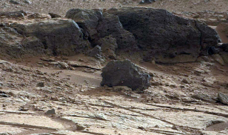 This image provided by NASA shows a rock outcrop in Gale Crater on Mars. The NASA rover Curiosity plans to study the outcrop before heading off to its ultimate science destination, a mountain rising from the middle of the crater, in the next several weeks.(AP Photo/NASA) Photo: Associated Press / NASA