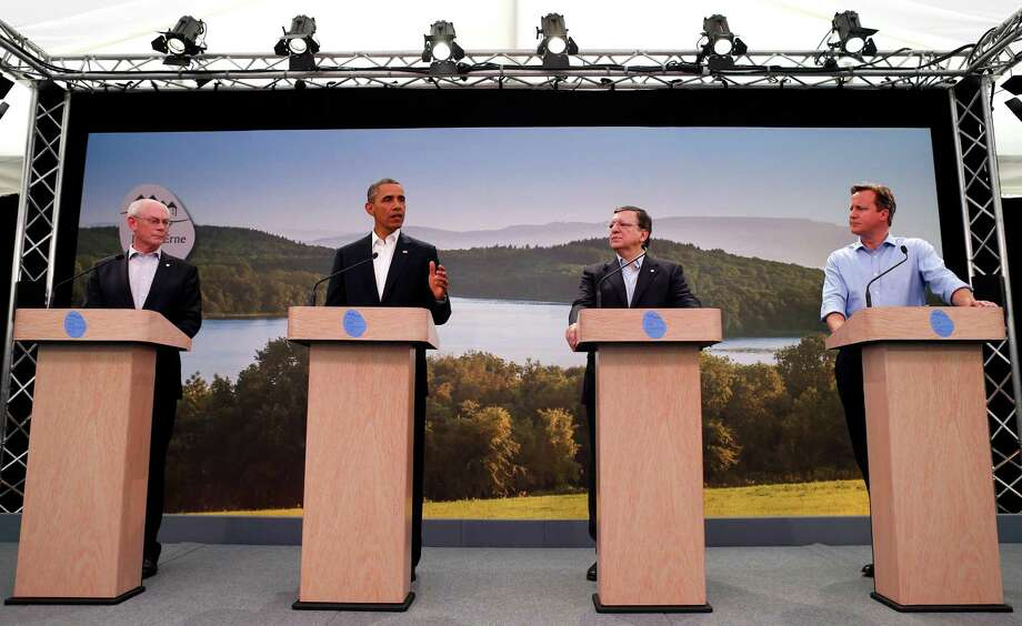 From right, Britain's Prime Minister David Cameron, European Commission President Jose Manuel Barroso, US President Barack Obama and European Council President Herman Van Rompuy participate in a media conference regarding EU-US trade at the G-8 summit in Enniskillen, Northern Ireland on Monday, June 17, 2013. British Prime Minister Cameron said he expects formal agreement to launch negotiations on a European-American free trade agreement. He also said a pact to slash tariffs on exports would boost employment and growth on both sides of the Atlantic. (AP Photo/Andrew Winning, Pool) Photo: Andrew Winning, Pool / Reuters Pool