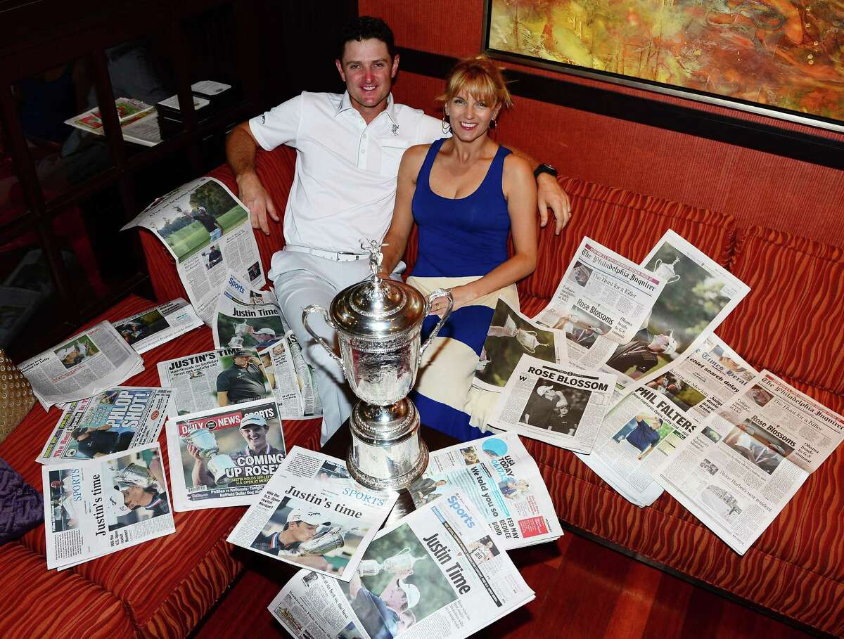 CONSHOHOCKEN, PA - JUNE 17: Justin Rose of England and his wife Kate Rose and the morning papers as they looked at the photographs and stories of his 2013 US Open win at Merion Golf Club at his hotel on June 17, 2013 in Conshohocken, Pennsylvania.