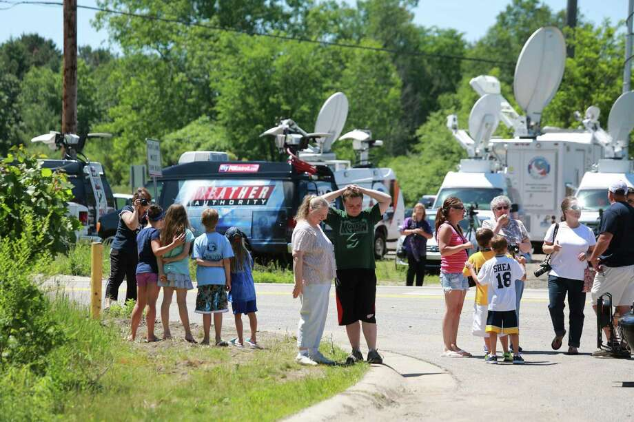 Neighbors gather as FBI, state and local authorities search a site in Oakland Township, Mich., that could be connected to the body of Jimmy Hoffa. Photo: Kathleen Galligan / Detroit Free Press