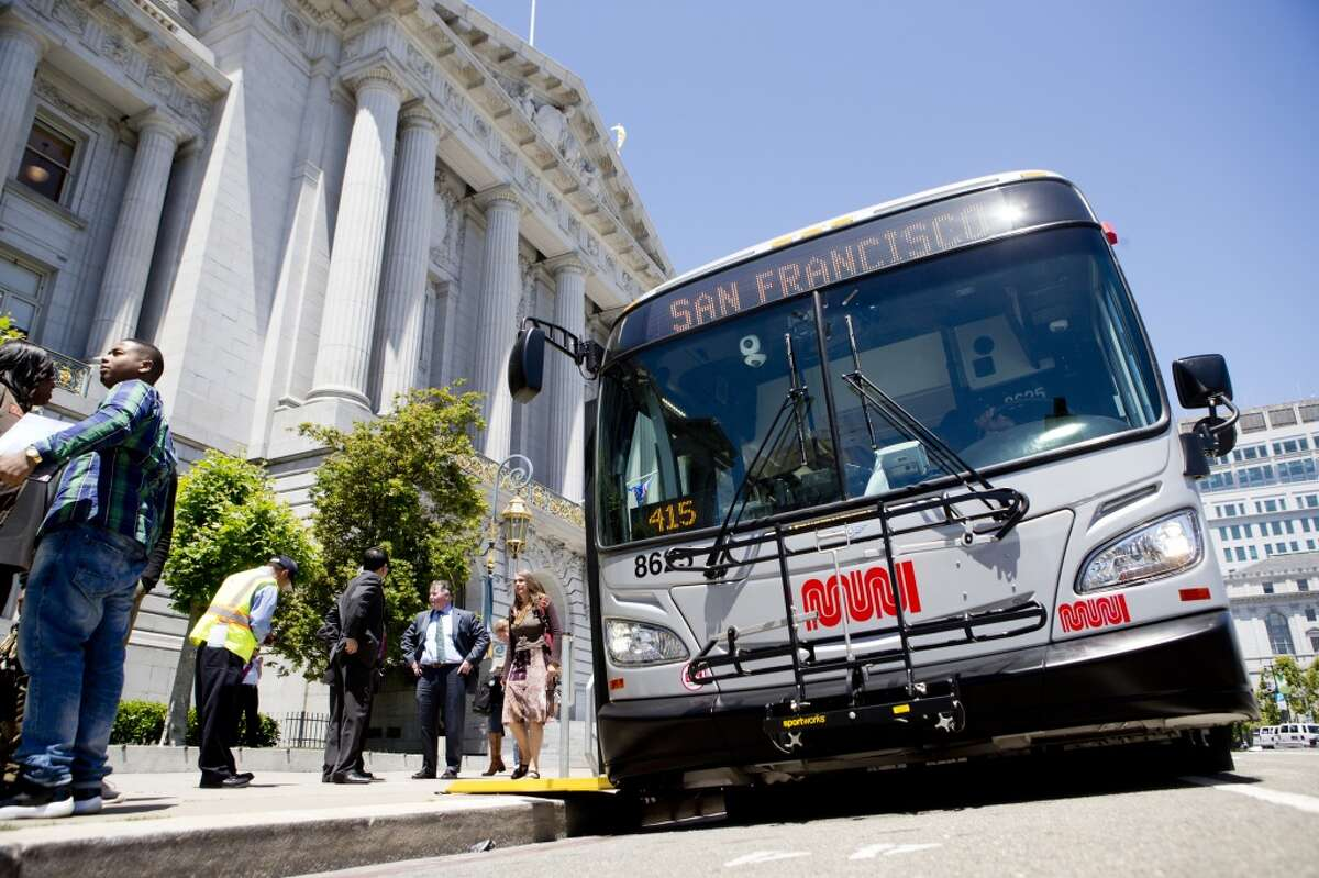 One of Muni's new bio-diesel hybrid buses sits parked outside City Hall Monday, June 17, 2013 in San Francisco, Calif.
