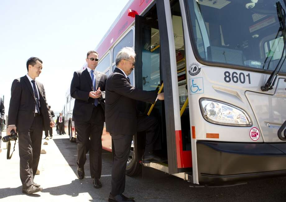 Mayor Ed Lee boards one of Muni's new bio-diesel hybrid buses for a ride to City Hall Monday, June 17, 2013 in San Francisco, Calif.