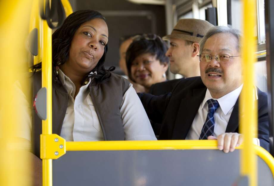 Muni driver Felicia Anderson and Mayor Ed Lee ride one of Muni's new bio-diesel hybrid buses to City Hall  Monday, June 17, 2013 in San Francisco, Calif.