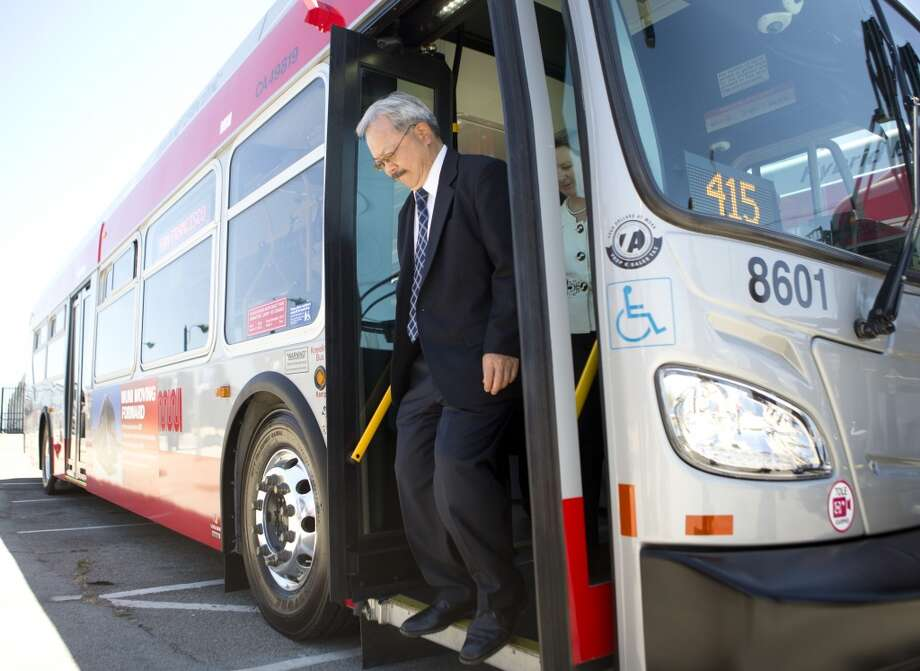 Mayor Ed Lee rides one of Muni's new bio-diesel hybrid buses to City Hall  Monday, June 17, 2013 in San Francisco, Calif.