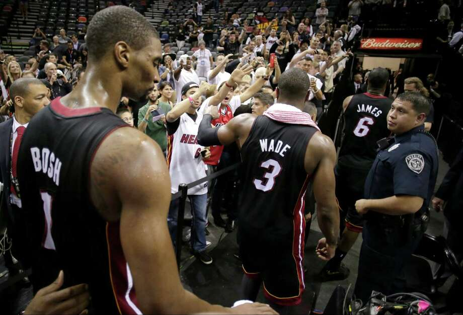Miami Heat's Chris Bosh (1), Dwyane Wade (3), and LeBron James (6) leave the floor after defeating San Antonio Spurs at Game 4 of the NBA Finals basketball series, Thursday, June 13, 2013, in San Antonio. The Heat won 109-93. (AP Photo/Eric Gay) Photo: Eric Gay