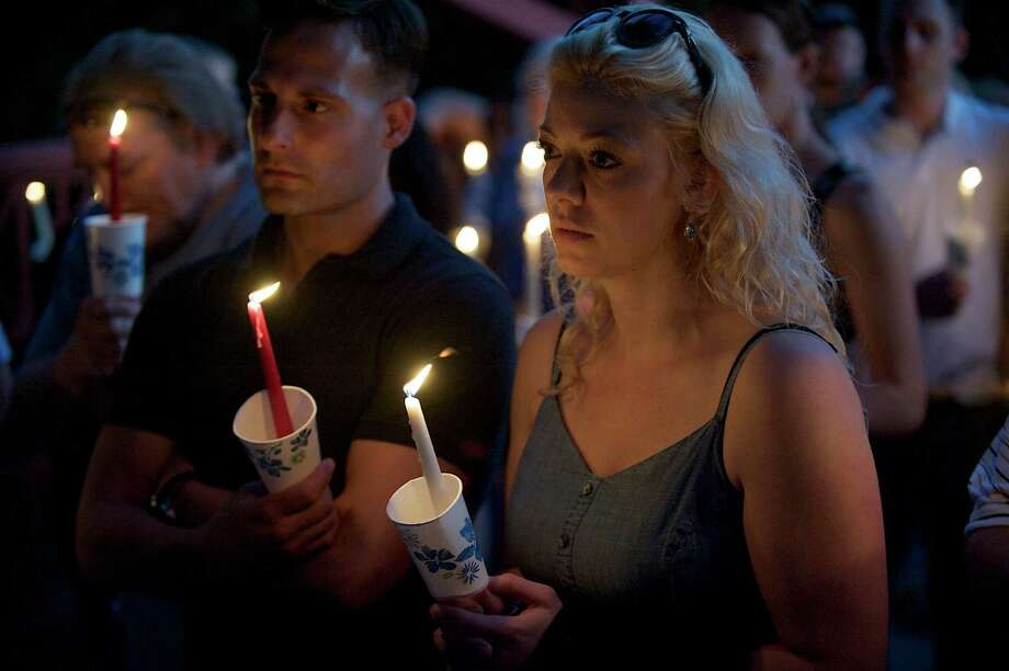 Jeff Blaiotta and Lindsey Blaiotta, of Danbury Conn, attend a candlelight vigil in Lovers Leap State Park in New Milford Conn, for Eric Langlois, on Monday June 17, 2013.  Langlois, of New Milford, has been missing since last Tuesday. The Blaiotta's work with and are friends of Langlois. Photo: H John Voorhees III