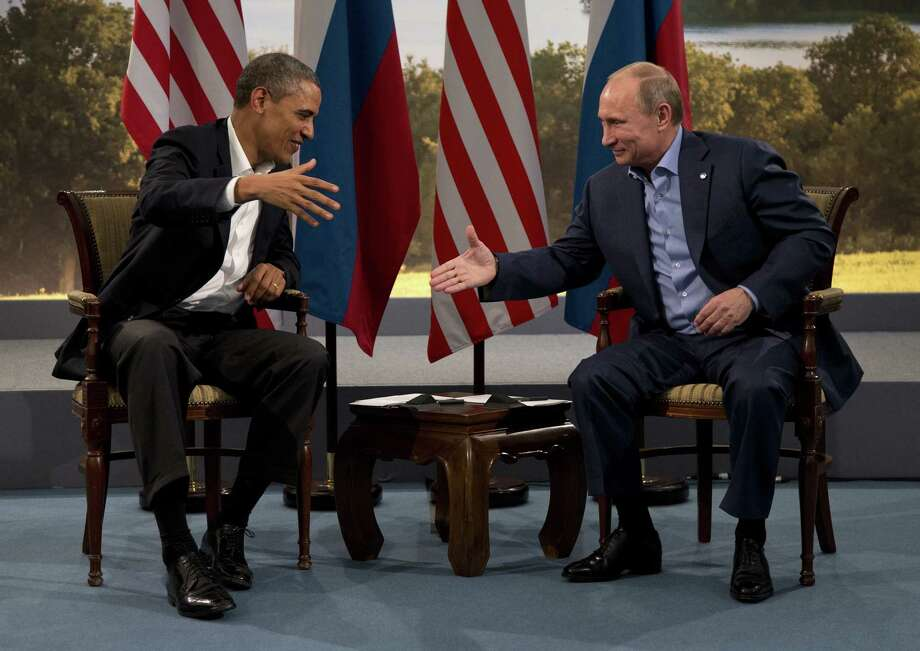 President Barack Obama and Russian President Vladimir Putin discussed the conflict in Syria during a visit on the sidelines of the G-8 meeting. Photo: Evan Vucci / Associated Press