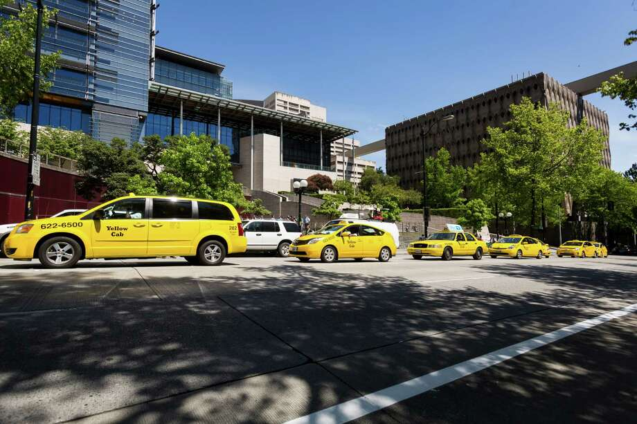 A line of yellow cabs sound their horns during a rally against unlicensed drivers and vehicles Monday, June 17, 2013, at Seattle City Hall in downtown Seattle. The Western Washington Taxicab Operators Association (WWTOA) delivered a petition with more than 500 signatures to the Seattle City Council in an effort to encourage regulation of such companies as Lyft, Sidecar and UBERx. Photo: JORDAN STEAD, SEATTLEPI.COM / SEATTLEPI.COM