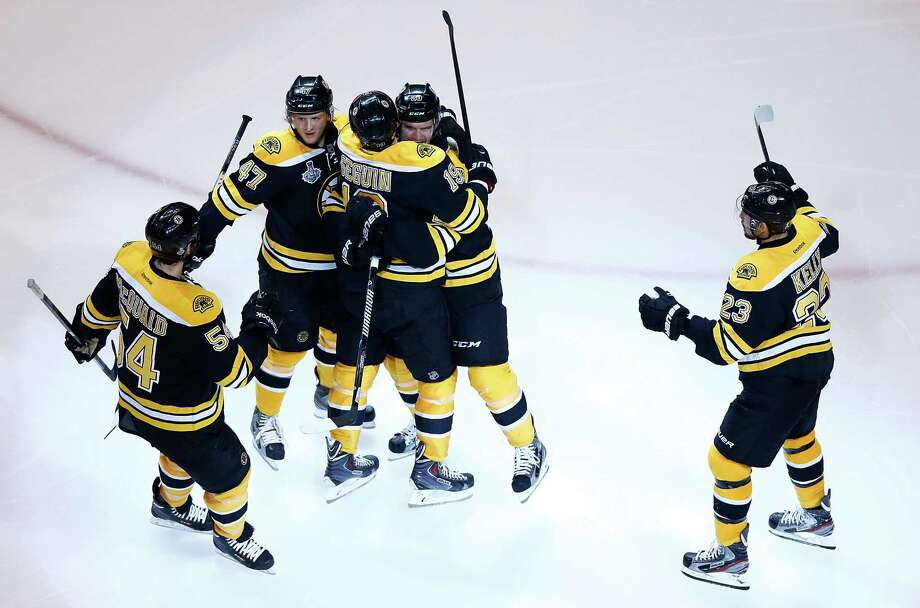 BOSTON, MA - JUNE 17:  Daniel Paille #20 of the Boston Bruins is congratulated by teammates Torey Krug #47, Tyler Seguin #19,  Adam McQuaid #54, and Chris Kelly #23 after scoring a goal in the second period against the Chicago Blackhawks during Game Three of the Stanley Cup Final on June 17, 2013 at TD Garden in Boston, Massachusetts. Photo: Jared Wickerham, Getty Images / 2013 Getty Images