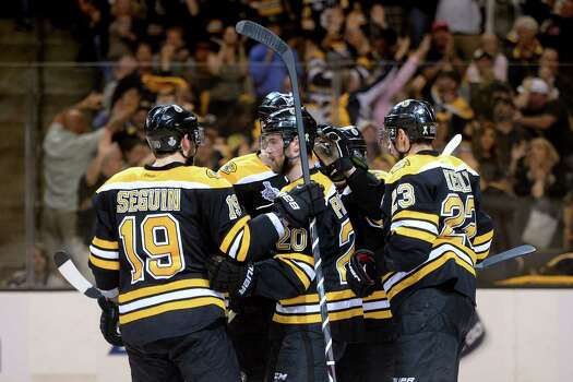 BOSTON, MA - JUNE 17: Daniel Paille #20 of the Boston Bruins celebrates with teammates Tyler Seguin #19 and Chris Kelly #23 after scoring a goal during the second period in Game Three of the 2013 NHL Stanley Cup Final at TD Garden on June 17, 2013 in Boston, Massachusetts. Photo: Harry How, Getty Images / 2013 Getty Images