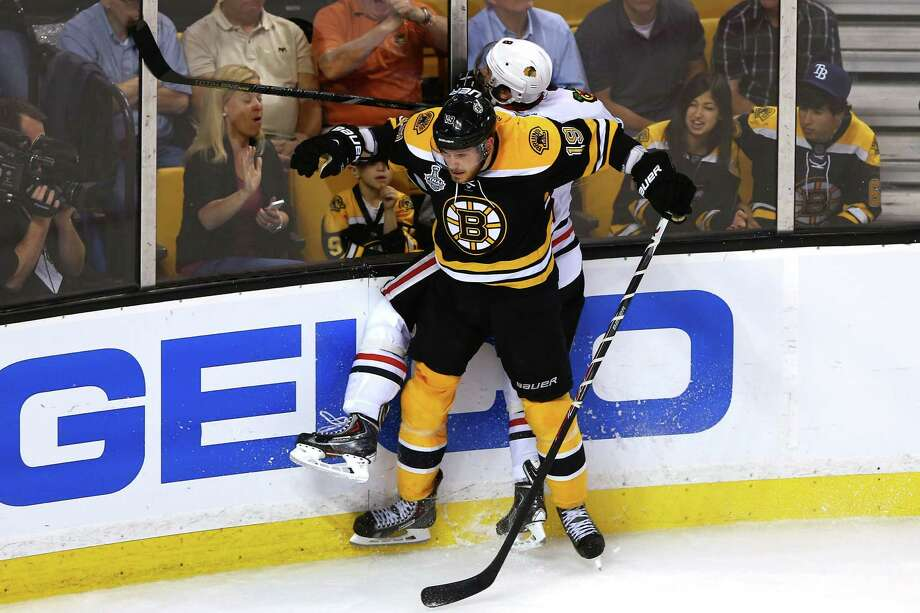 BOSTON, MA - JUNE 17: Tyler Seguin #19 of the Boston Bruins collides with Nick Leddy #8 of the Chicago Blackhawks in Game Three of the 2013 NHL Stanley Cup Final at TD Garden on June 17, 2013 in Boston, Massachusetts. Photo: Elsa, Getty Images / 2013 Getty Images