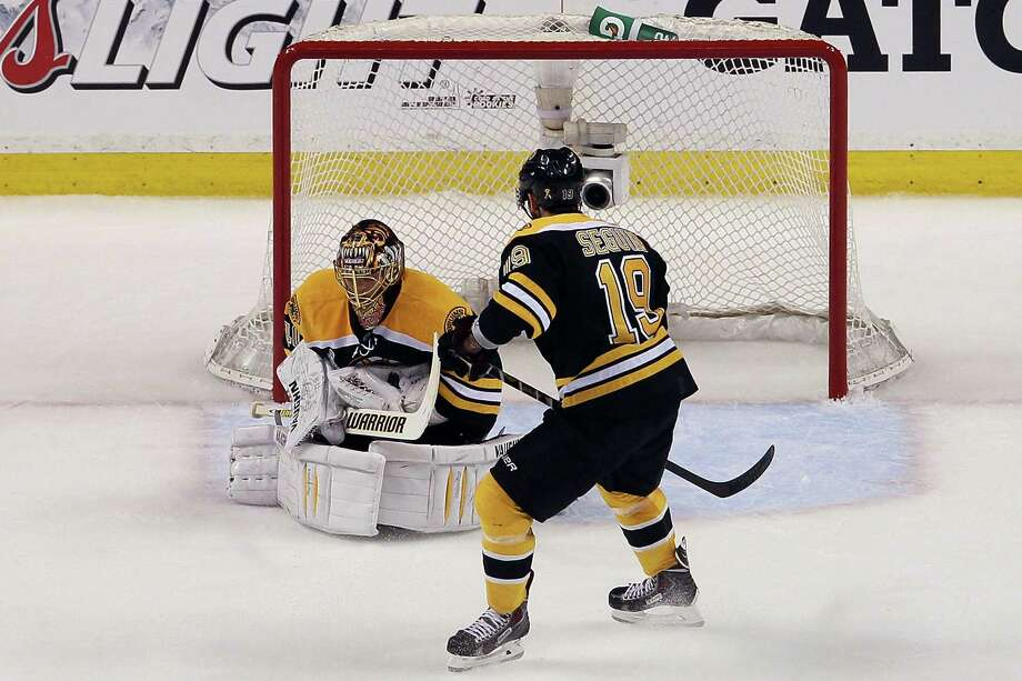 BOSTON, MA - JUNE 17: Tuukka Rask #40 of the Boston Bruins makes a save as Tyler Seguin #19 looks on against the Chicago Blackhawks in Game Three of the 2013 NHL Stanley Cup Final at TD Garden on June 17, 2013 in Boston, Massachusetts. Photo: Elsa, Getty Images / 2013 Getty Images