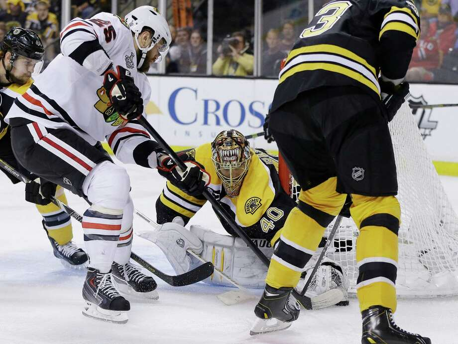 Boston Bruins goalie Tuukka Rask (40), of Finland, stops an attempt by Chicago Blackhawks left wing Viktor Stalberg (25), of Sweden, during the third period in Game 3 of the NHL hockey Stanley Cup Finals in Boston, Monday, June 17, 2013. (AP Photo/Elise Amendola) Photo: Elise Amendola, Associated Press / AP