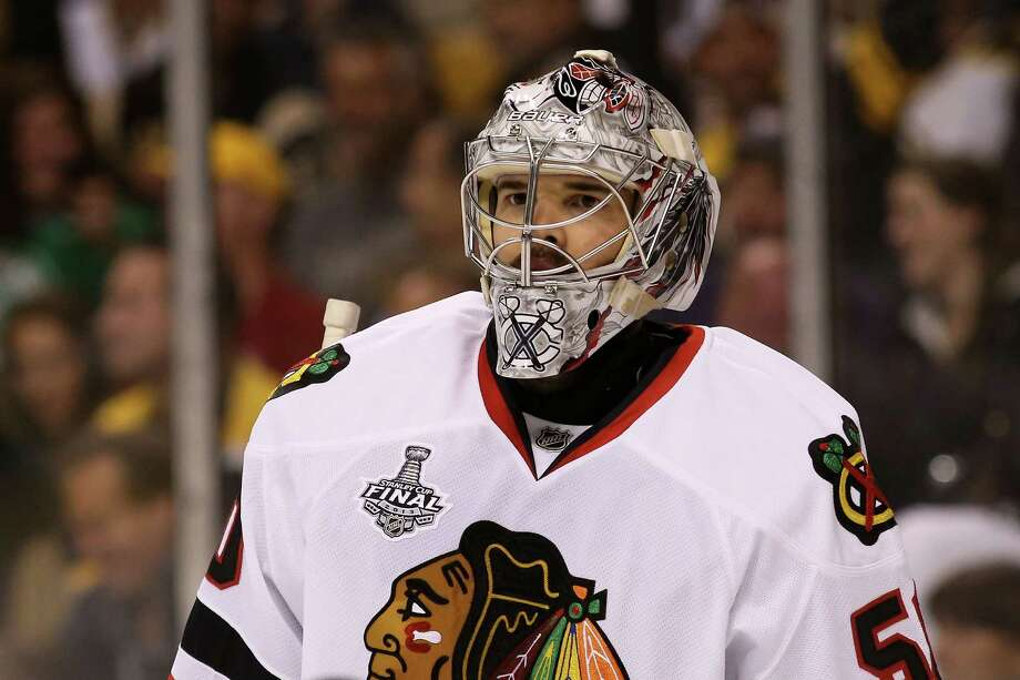 BOSTON, MA - JUNE 17: Corey Crawford #50 of the Chicago Blackhawks looks from the ice against the Boston Bruins in Game Three of the 2013 NHL Stanley Cup Final at TD Garden on June 17, 2013 in Boston, Massachusetts. Photo: Bruce Bennett, Getty Images / 2013 Getty Images
