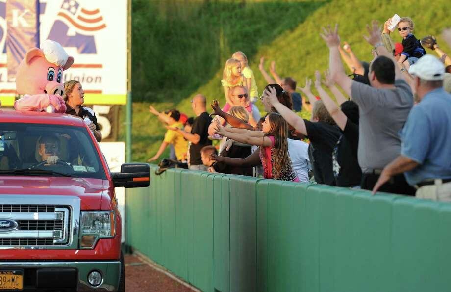 Tri-City ValleyCats fans try to catch a t-shirt thrown from a truck during a baseball game against the Vermont Lake Monsters at Joe Bruno Stadium on Monday, June 17, 2013 in Troy, N.Y. (Lori Van Buren / Times Union) Photo: Lori Van Buren / 10022829A