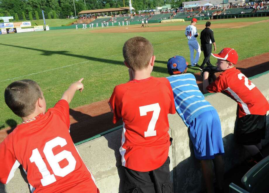 Young boys try to get autographs before the Tri-City ValleyCats baseball game against the Vermont Lake Monsters at Joe Bruno Stadium on Monday, June 17, 2013 in Troy, N.Y. (Lori Van Buren / Times Union) Photo: Lori Van Buren / 10022829A