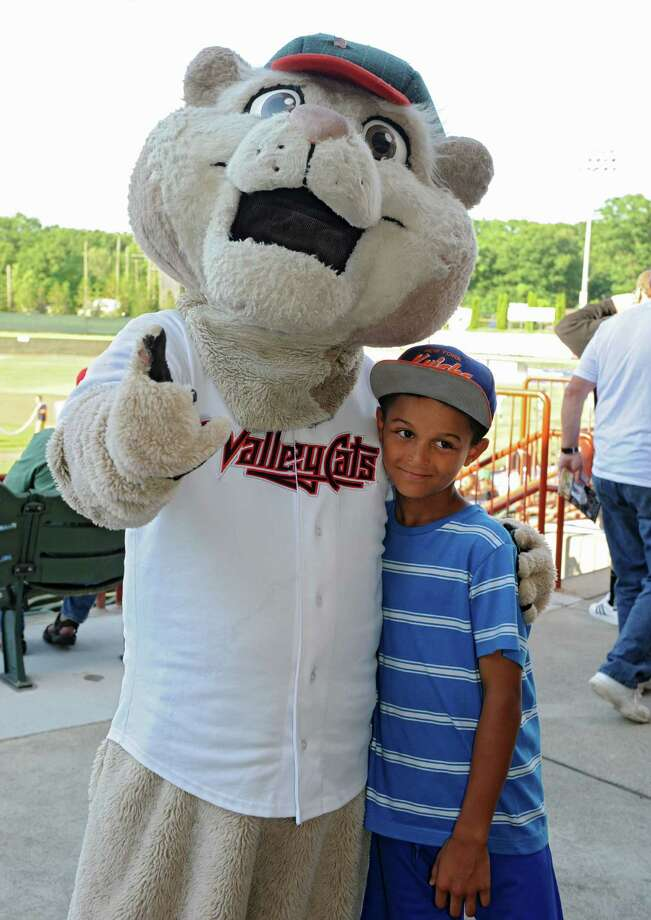 Nazareth Lozada, 7, of Troy gets his photo taken with mascot Pappy SouthPaw before the Tri-City ValleyCats baseball game against the Vermont Lake Monsters at Joe Bruno Stadium on Monday, June 17, 2013 in Troy, N.Y. (Lori Van Buren / Times Union) Photo: Lori Van Buren / 10022829A