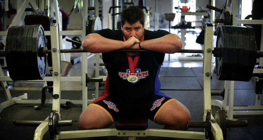 Ryan Carrillo, a former offensive lineman at O'Connor, won the International Powerlifting Federation's junior heavyweight title in the bench press last month. Photo: Photos By Bob Owen / San Antonio Express-News