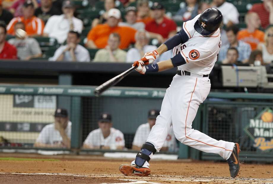 Jason Castro of the Astros hits an RBI double against the White Sox.