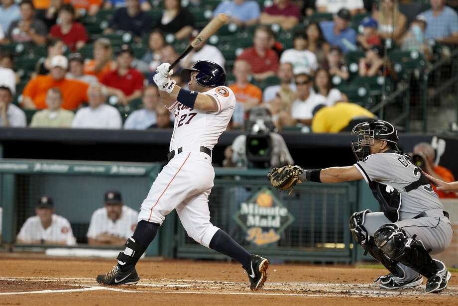 Astros second baseman Jose Altuve hits a single.